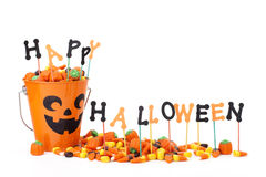 Happy Halloween sign with candy & candy bucket Stock Image