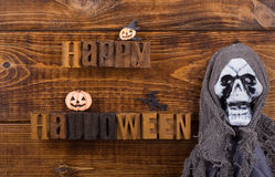 Happy Halloween Sign. With halloween decorations on a wood background Stock Photography