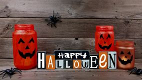 Happy Halloween sign with flickering mason jar Jack o Lanterns stock footage