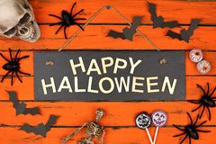 Happy Halloween sign and frame of decor on orange wood Royalty Free Stock Photos