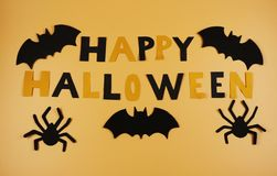 A happy halloween sign with some black bats and spiders. Trick or treating. American holiday. Witches and cauldrons. Orange and bl. Ack. Scare. Fear royalty free stock photography