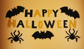 A happy halloween sign with some black bats and spiders. Trick or treating. American holiday. Witches and cauldrons. Orange and bl. Ack. Scare. Fear. Ghost royalty free stock photography
