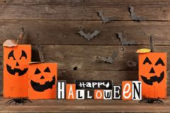 Happy Halloween sign with wooden Jack o Lanterns Stock Photography