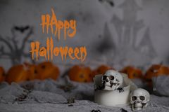 Happy Halloween. Skull on an old used thick candle. Scary Hallow. Skull on an old used thick candle. Scary Halloween background. Closeup stock photo