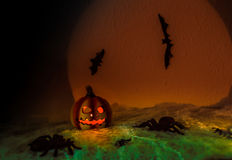 Happy Halloween. Spooky Halloween Night,,halloween pumpkin, and many flying bats on abstract background with big moon and spiders Stock Photos