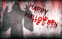 Happy Halloween sprayed on wall next ghostly shadow Stock Image