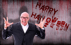 Happy Halloween sprayed on wall next to screaming businessman Royalty Free Stock Image