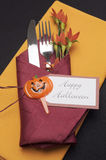 Happy Halloween table place setting with red and orange napkins - aerial. Stock Image