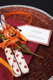 Happy Halloween table place setting with red polka dot cutlery. Close up. Royalty Free Stock Images