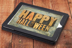 Happy Halloween on a tablet. Happy Halloween typography - letterpress wood type printing blocks on a digital tablet stock photo