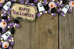 Happy Halloween tag with candy corner border over aged wood Royalty Free Stock Images