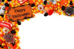 Happy Halloween tag with candy corner border over white Royalty Free Stock Image