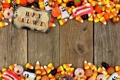 Happy Halloween tag with candy double border over rustic wood Royalty Free Stock Photography