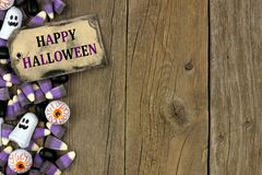 Happy Halloween tag with candy side border over aged wood Royalty Free Stock Images