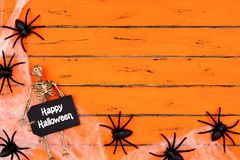 Happy Halloween tag with spider web corner border on orange wood Royalty Free Stock Photo