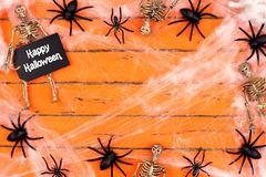 Happy Halloween tag with spider web frame on orange wood Stock Photos