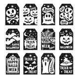 Happy halloween tags set white color on black background with skull, pumpkin, spider, bat Stock Photos