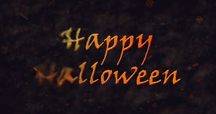 Happy Halloween text dissolving into dust to left Royalty Free Stock Photography
