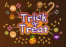 Happy Halloween Trick or Treat Greeting Card With Sweets on Old Web Wood Background Stock Photography