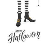 Happy Halloween with witches legs in shoes Stock Photo