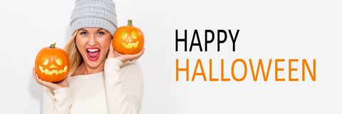 Happy Halloween with woman holding pumpkins. Happy Halloween with young woman holding pumpkins royalty free stock photo