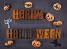 Happy Halloween Wooden Block Text on a Black Background Royalty Free Stock Photo