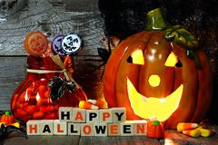 Happy Halloween wooden blocks, night scene with Jack-o-Lantern and candy Stock Images