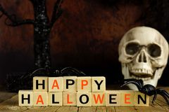Happy Halloween wooden blocks with skull and decor Royalty Free Stock Photos