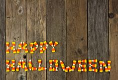 HAPPY HALLOWEEN written with candy corn over rustic wood Stock Photography