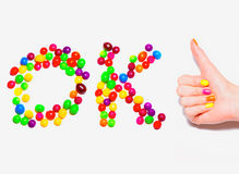 Happy hand thumbs up with colorful manicure and ca Royalty Free Stock Image