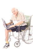 Happy handicap man checking emails. Isolated on white Royalty Free Stock Photos