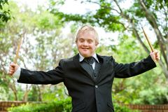 Happy handicapped musician. Royalty Free Stock Image