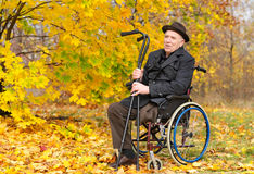 Happy handicapped senior enjoying the autumn sun Royalty Free Stock Photo