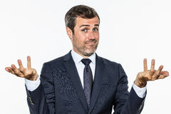 Happy handsome business man showing hands up for carefree success Stock Image