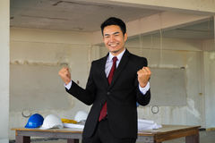 Happy handsome businessman acting hooray Royalty Free Stock Image