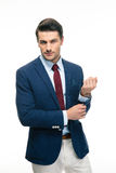 Happy handsome businessman buttoning jacket Royalty Free Stock Photo