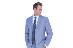 Happy handsome businessman smiling with hands on pockets. On white background Royalty Free Stock Image
