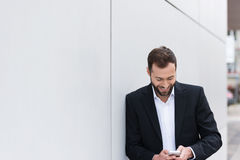 Happy Handsome Businessman Texting on Phone Stock Photo