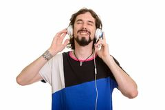 Happy handsome Caucasian man listening to music with eyes closed. Isolated against white background stock photography