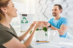Exuberant architects holding a house miniature Royalty Free Stock Images