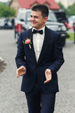 Happy handsome confident groom in stylish suit walking to the ai Stock Photography