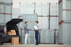Happy customer shaking hand of storage manager Royalty Free Stock Photo
