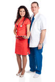 Happy handsome doctor and sexy nurse Stock Images