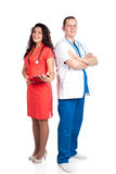 Happy handsome doctor and sexy nurse. Happy couple of handsome men doctor and pretty nurse in blue, white and tangerine tango uniforms, looking at camera. Full Royalty Free Stock Photo