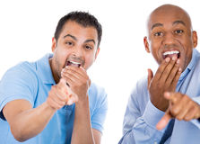 Happy, handsome, excited male guys pointing fingers and laughing at you Royalty Free Stock Photo