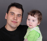 Happy handsome father holds his little baby Stock Image