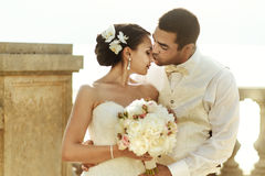 Happy handsome groom and beautifyl bride hugging on balcony at s Stock Photography