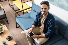 Happy handsome guy with beard spending free time at home Stock Photo