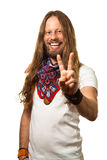 Happy and handsome guy giving a peace sign. Portrait of a smiling and handsome man giving a peace sign isolated on white stock image