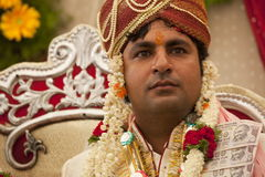 Happy handsome Indian groom. At his wedding Stock Photography